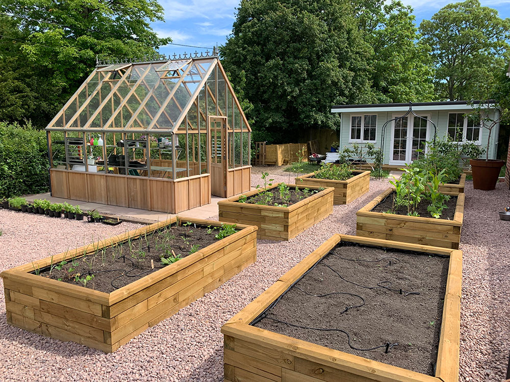 Kitchen Garden with greenhouse and wooden raised beds Monk Sherborne Tadley Hampshire
